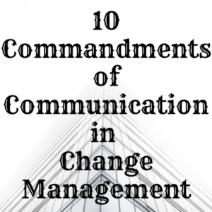 Writing stating 10 Commandments in Change Management behind a skyscraper